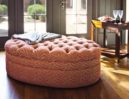 Cocktail ottomans, such as the Marilyn ottoman by Jessica Charles, provide  room for seating