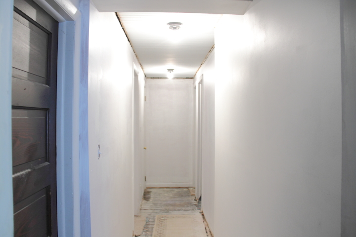 hallway finally. one trick that i learned to get really smooth walls is lightly sand a wall was raw drywall after you prime it the reason sanded hallway finally