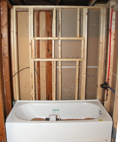 With All Of The Plumbing In And The Rough Approval Complete I Set About  Installing A Vapor Barrier For The Bathroom Shower Surround.