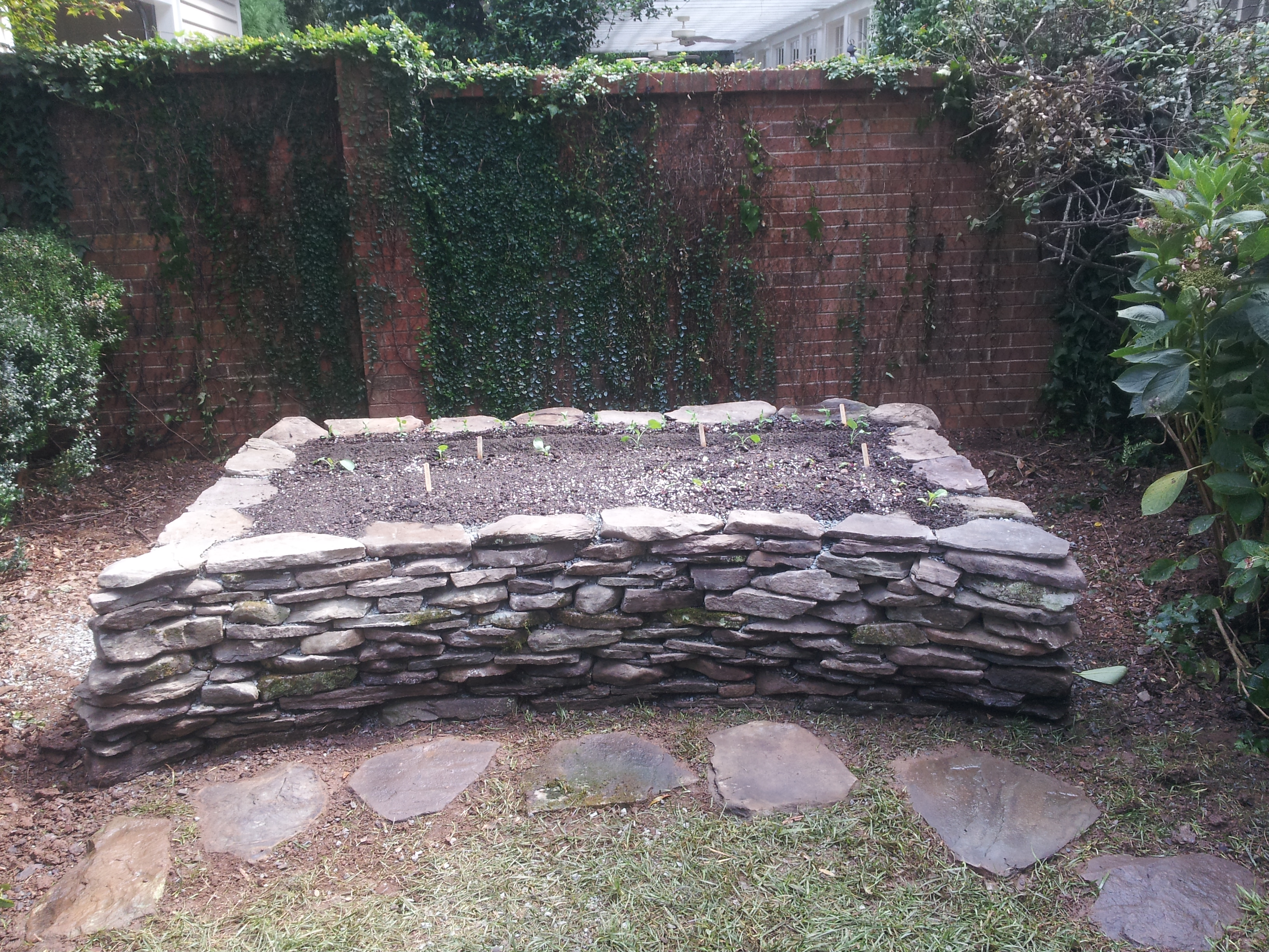 Rogers Garden Stone Raised garden beds for sale in charlotte nc microfarm organic gardens and a tranquil sense of permanence nothing can rival natural stone it affords the ability to incorporate softer lines and curves in garden structures workwithnaturefo
