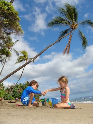 photo of children playing in the sand in hawaii
