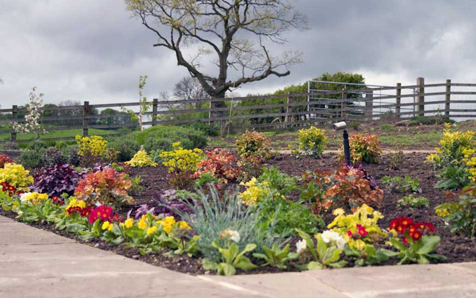 Garden design ideas hornby garden designs garden for Large flower bed design ideas