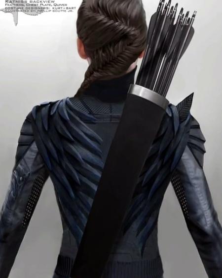 Mockingjay Part 1 Costume Designers On The Mockingjay Suit Peeta S Changing Wardrobe How Effie Made It Work The Hunger Games News Panem Propaganda
