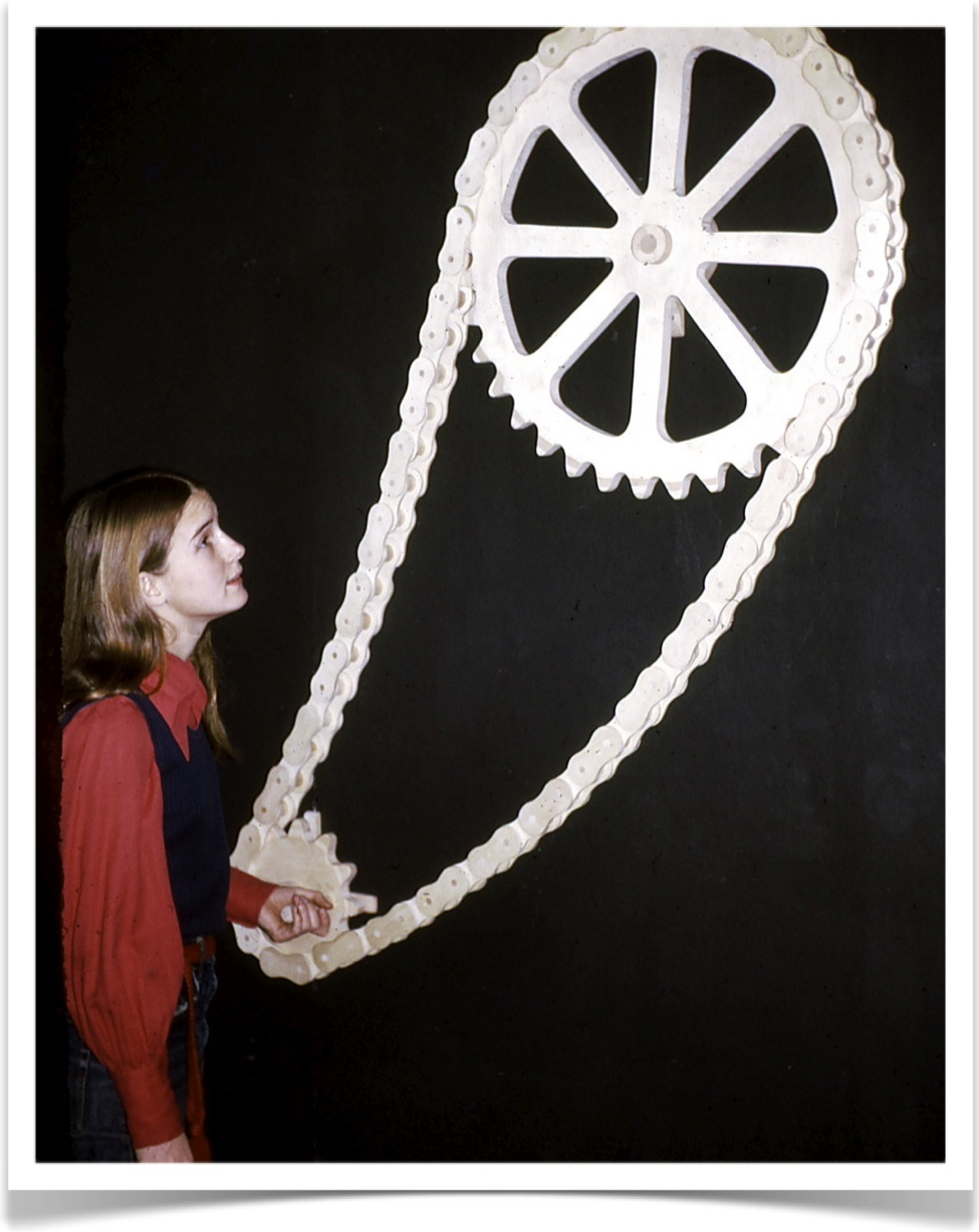 Marji Roy with kinetic sculpture at Wood That Works