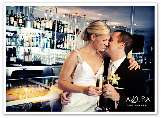 Bride and Groom with champagne at the Edgewater Hotel