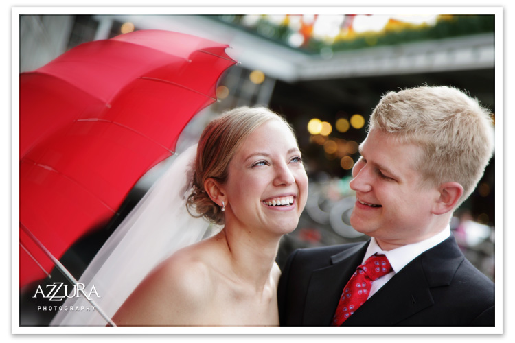 Wedding couple with red Bella Umbrella at Seattle's Pike Place Market