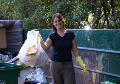 Photo of artist Erin Wade collecting trash for her recycled art piece Fruits of Refuse.