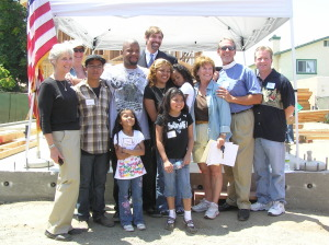 Dr. Henry T. Nicholas III joins members of the Martinez-Moran family and officials from Habitat for Humanity and the Episcopal Diocese of Los Angeles to build a home in Westminster.