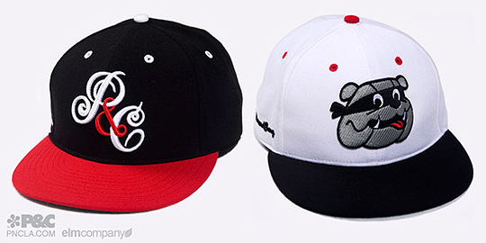 ff5608de18c2a ... fitted cap rocks a white black two-tone style with red button and  eyelets. Both caps are made with premium wool and laced with green under  visors.