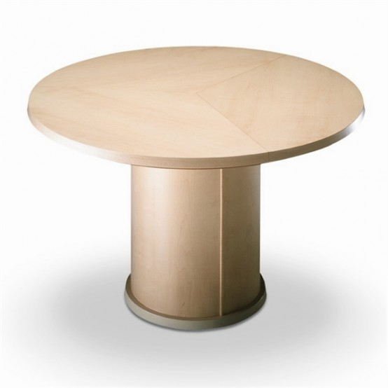 trendy expandable round dining table by skovby