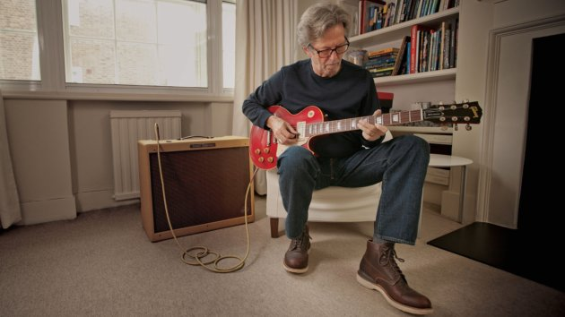 eric clapton helps create collection of guitars to benefit his