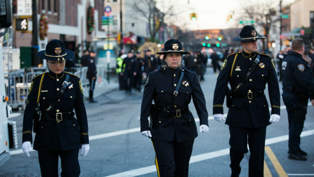 Thousands Gather for Slain NYPD Officer's Funeral