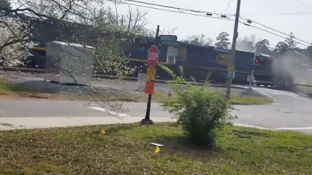 Caught on camera: Freight train slams into tractor-trailer in Georgia