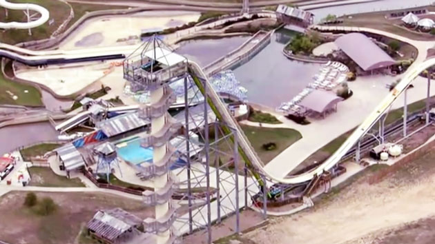 Designer of waterslide that killed boy surrenders to police after returning to country