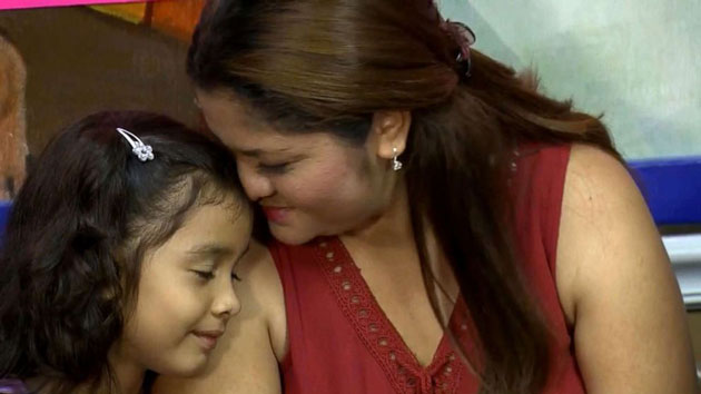 Six-year-old girl heard asking through tears to call family is reunited with mother