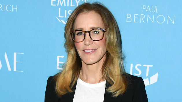 After pleading guilty in college scam, Felicity Huffman all smiles at daughter's high school graduation