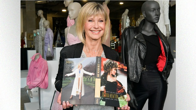 Anonymous billionaire who bought Olivia Newton-John's 'Grease' leather jacket returns it to her