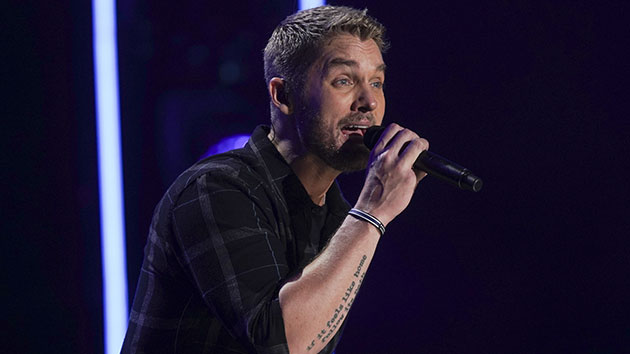 While self-quarantining on his tour bus, Brett Young is missing his wife and baby daughter