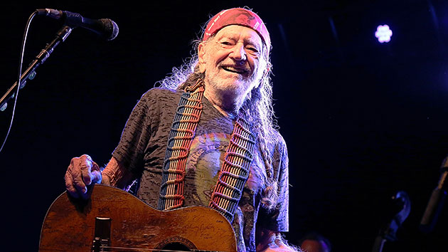 Willie Nelson gives a thumbs-up after receiving first dose of the COVID-19 vaccine
