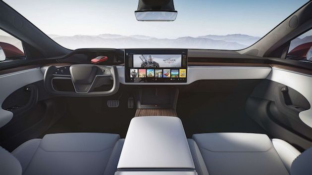 Giant screens, spartan interiors: Electric vehicles go high tech