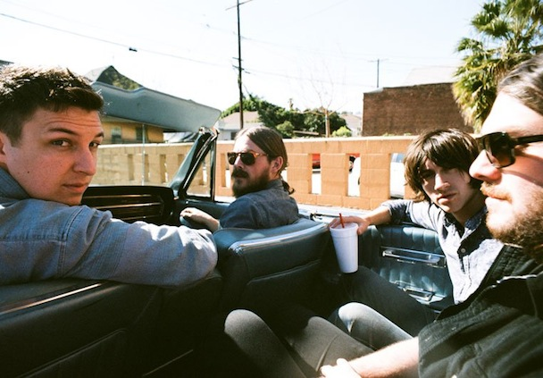 The band Arctic Monkeys in a car
