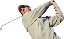 Photo of golfer swinging club at The Mackinaw Club Golf Course in Macinaw City, MI.