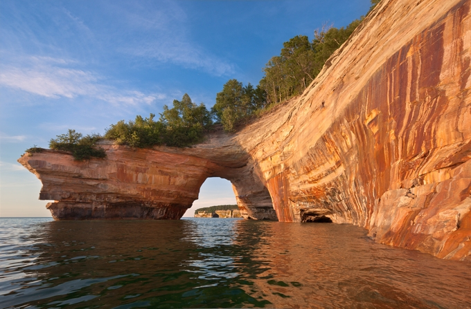 "Image of ""Lovers Leap,"" an imposing arch of rock extending from the shoreline of Lake Superior. Photo provided courtesy of http://www.picturedrocks.com/."