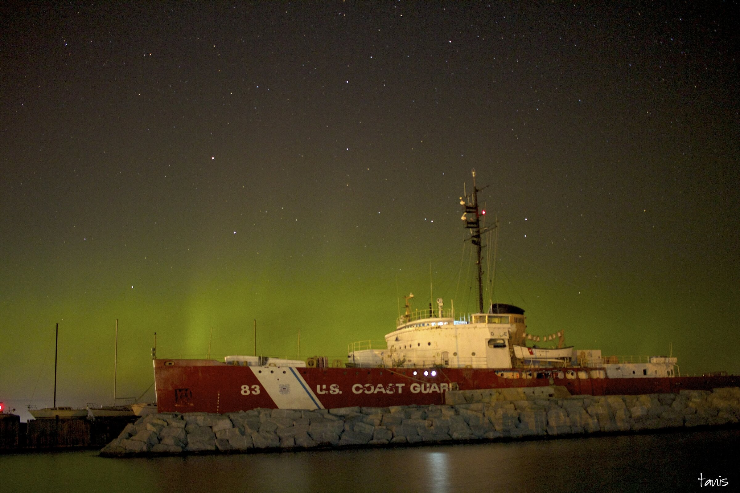 Photo of the Northern Lights over a coast guard ship in Mackinaw City, MI. Copyright 2016, Brian Tannis, lovethegreatlakesstate.com.