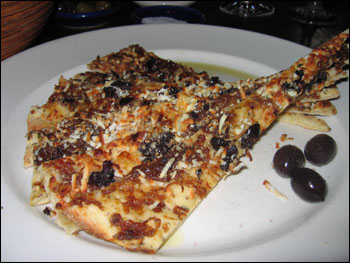 kalamata pita - flatbread of caramelized onion, kalamata olives, myzithra & parmesan cheese
