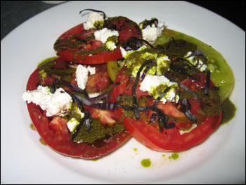 heirloom tomato salad with manouri cheese and basil oil