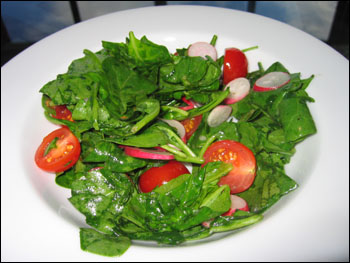 arugula salad with cherry tomatoes and radishes