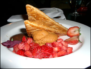 caramel carnivale - caramel mousse, puff pastry, fresh fruit, rasberry puree, and chocolate caramel sauce