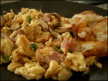 3 egg scramble with bacon, mushrooms, onions, scallions, and hash browns