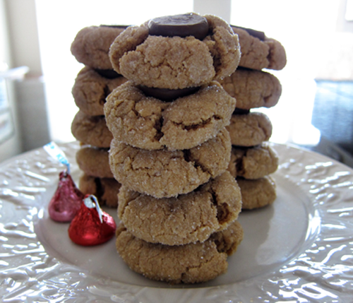 Photograph showing how the modified peanut butter kiss cookies stack neatly, with no wobbling. From thestrengthbehindthestrong.com.