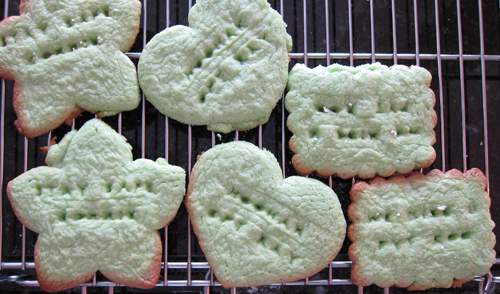 Photograph of baked cookies which puffed up during baking; the messages are illegible. The cookies are also burned at the edges. From thestrengthbehindthestrong.com.