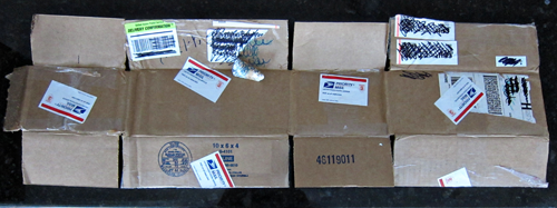 Image of the military care package box cut along the glued seam and flattened out into a single layer of cardboard. From TheStrengthBehindTheStrong.com.