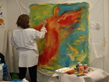 A participant in artist Cynthia Schildhauer's Intuitive Painting workshop