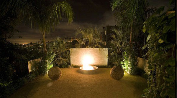 Designer profile masters of lighting drama home for Luxury landscape lighting