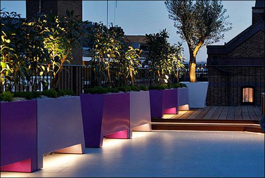 Designer profile amir schlezinger well lit planters for Luxury landscape lighting