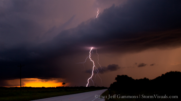 Cloud-to-ground lightning strike with sunset FL thunderstorm.