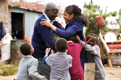 Maruge and the children welcome Jane back to school