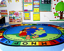A soft circle time rug for group fun in one of our colorful classrooms