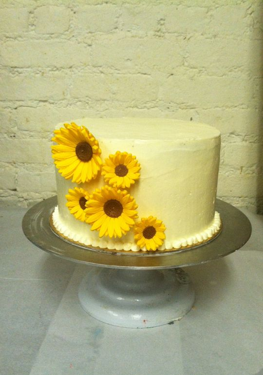 another simple cake with some edible sunflowers sorry also not a great picture another simple yet elegant bridal shower