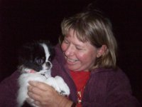 Judy Frey and her black and white japanese chin male