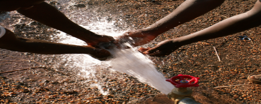 Hands with flowing water