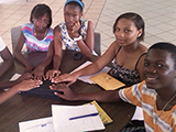 Young members of a savings group that contributes to disaster risk reduction in the Caribbean