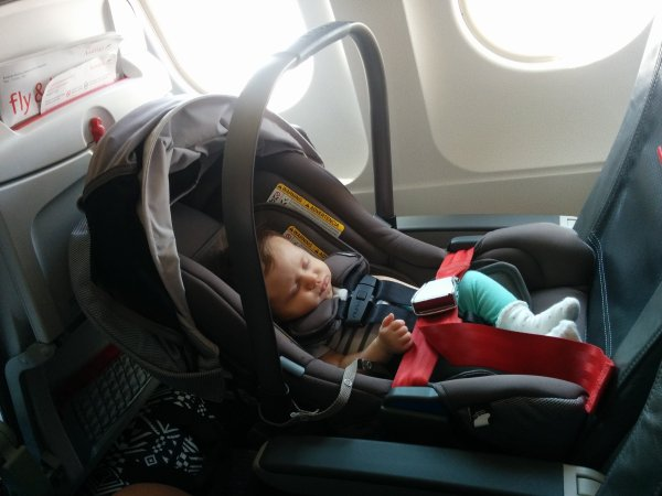 Photo Left Baby Luna Securely Fastened On Austrian Airlines Flight 130 From FRA To VIE Economy Class