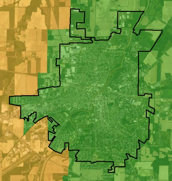 GIS real estate suitability-suitable areas for real estate are within the local school district (green) and the town boundary, which is the area encompassed by the black line below.