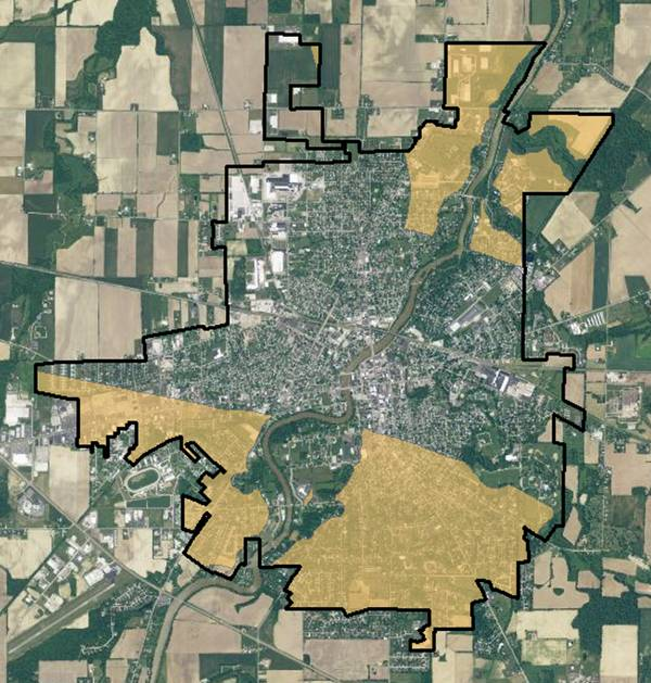 GIS real estate suitability-to this point, the suitable areas for real estate are shown in light brown below