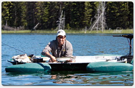 Don Freschi catching a beautiful Rainbow Trout in his Frog Boat